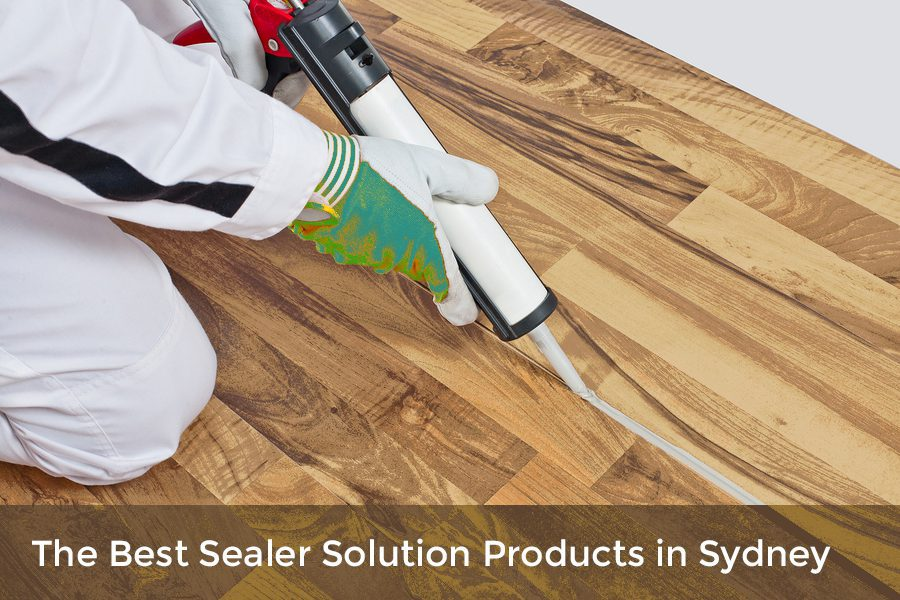 The man is using sealer solution for flooring
